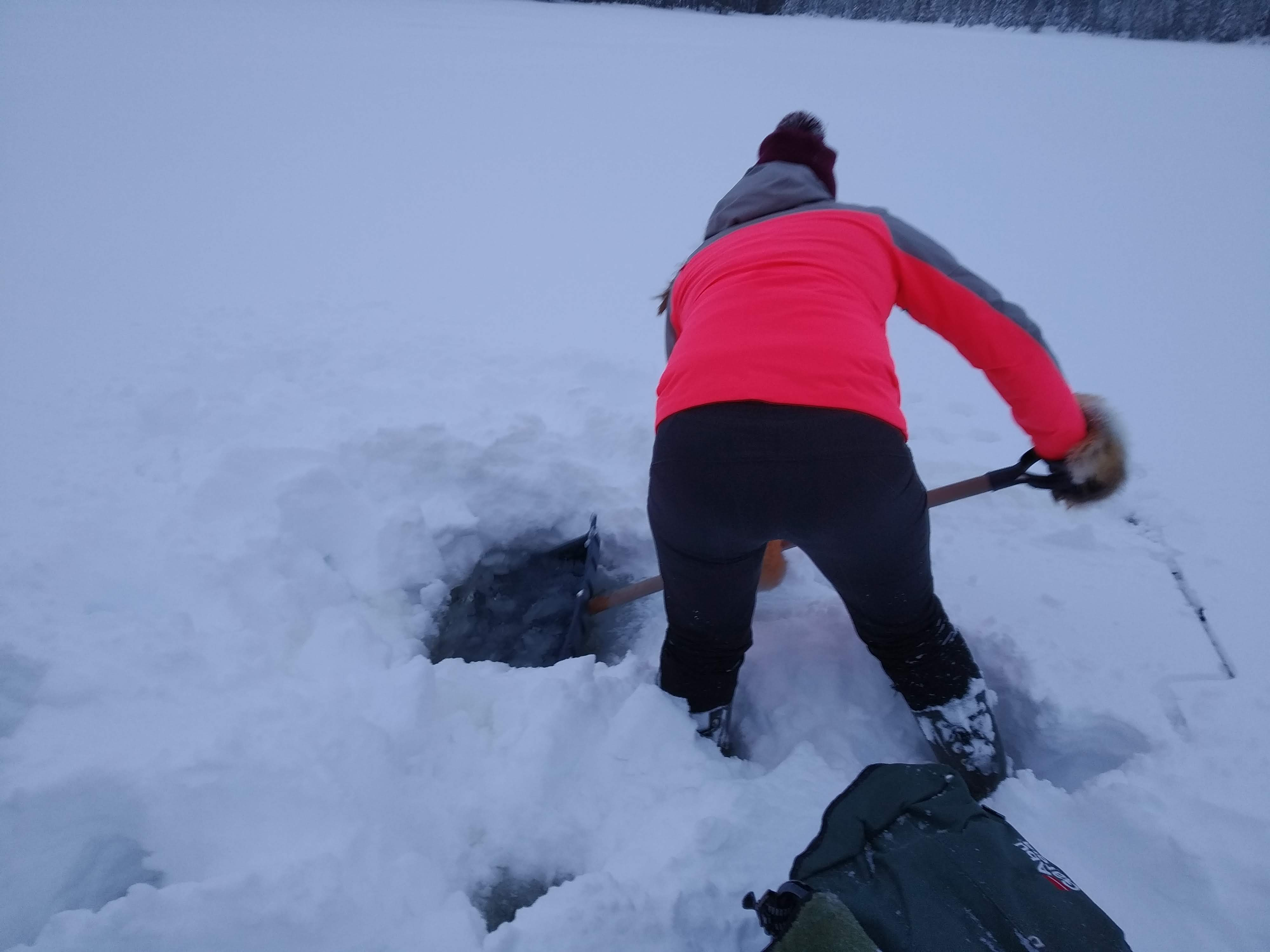 Venla digging the hole for ice fishing